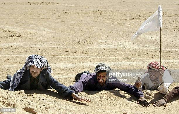 Iraqi men surrender to US Army 3rd Division 37 Infantry soldiers during a search and destroy mission March 27 2003 near the town of An Najaf Iraq The...