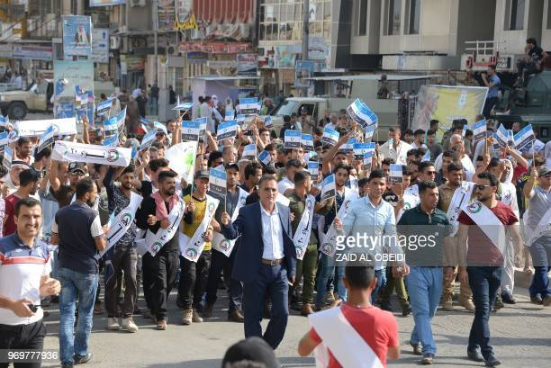 Iraqi men take part in a rally in Mosul on June 8 to mark Quds day a commemoration first initiated by Iran in 1979 to fall on the last Friday of the...