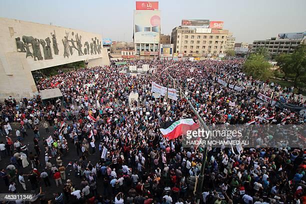 Iraqi men wave their national flag during a demonstration against corruption and poor services in Baghdad on August 7 2015 Several thousand...