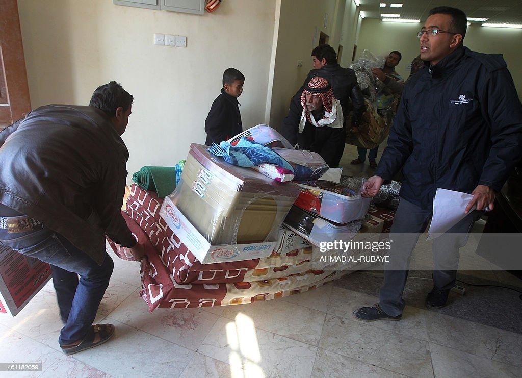 IRAQ-POLITICS-UNREST-RAMADI-REFUGEE : News Photo