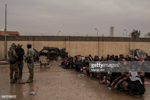 Iraqi men who have fled fighting in west Mosul between Islamic State and Iraqi forces have been separated from their families to be registered and...
