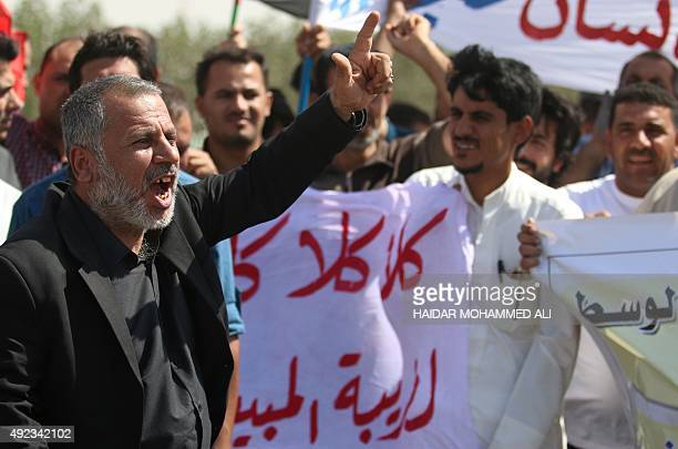 Iraqi merchants from the Basra region demonstrate outside the gate of the port of Um Qasr to scrap the new tax law on October 12 2015 AFP PHOTO /...