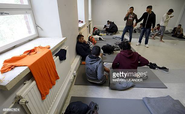 Iraqi migrants are pictured inside a refugee center located in former barracks in Lahti Finland on September 25 2015 The asylum seekers were...