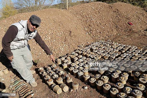 Iraqi minehunter shows removed land mines laid by Ba'ath Party on the mountainous terrain of Penjwin district near IraqiIranian border crossing in...