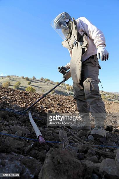 Iraqi minehunters clear land mines laid by Ba'ath Party on the mountainous terrain of Penjwin district near IraqiIranian border crossing in...