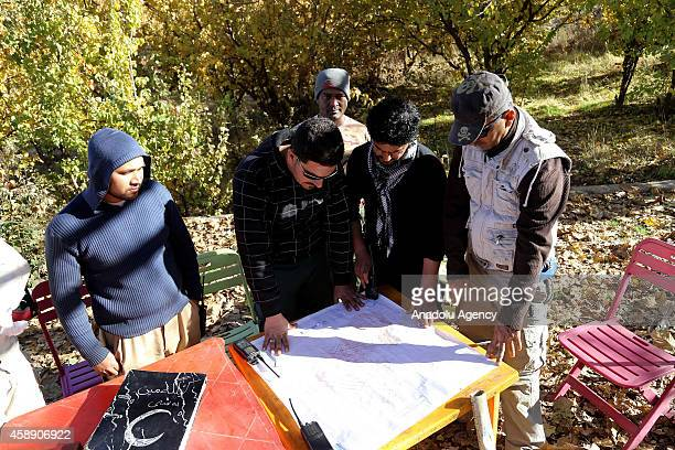 Iraqi minehunters look at the map showing land mines laid by Ba'ath Party on the mountainous terrain of Penjwin district near IraqiIranian border...