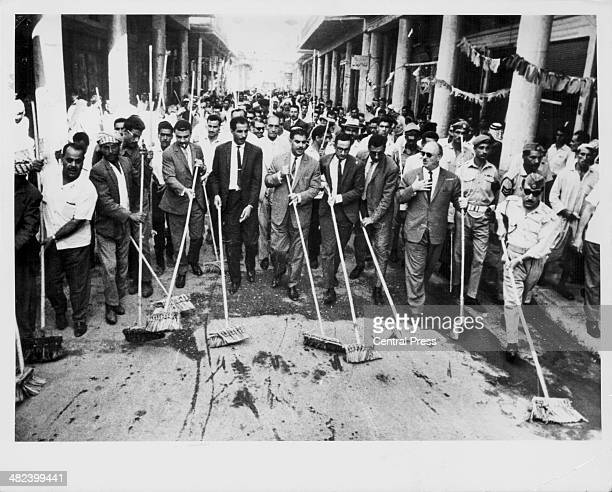 Iraqi Minister of State Sayid Hamid Al-Jibouri joining citizens to clean up the city of Nasiriyah, Iraq, September 16th 1969.