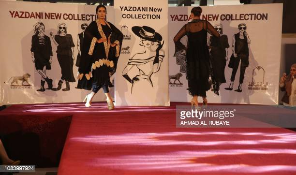 Iraqi models present an outfit designed by an Iranian female fashion designer during a show at a shopping mall in the Iraqi capital Baghdad on...