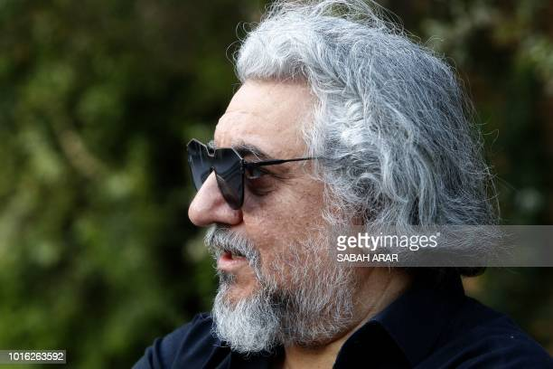 Iraqi Mohammed Amin Ezzat conductor in the Iraqi National Symphony Orchestra talks during an interview in Baghdad on August 5 2018 Some 40 musicians...