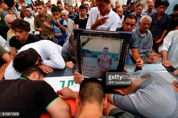 Iraqi mourners attend the funeral of a soldier who was killed in the ongoing military operation to retake the city of Mosul from the Islamic State...