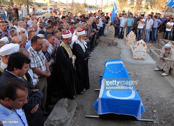 Iraqi mourners attend the funeral of Munir alQafili a city council chief of Iraq's ethnically divided northern oil hub of Kirkuk after he was...