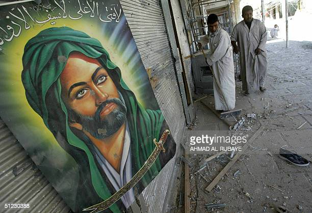 Iraqi municipal workers clean up the area off the Imam Ali shrine in the holy city of Najaf 28 August 2004 as the threeweek standoff between radical...