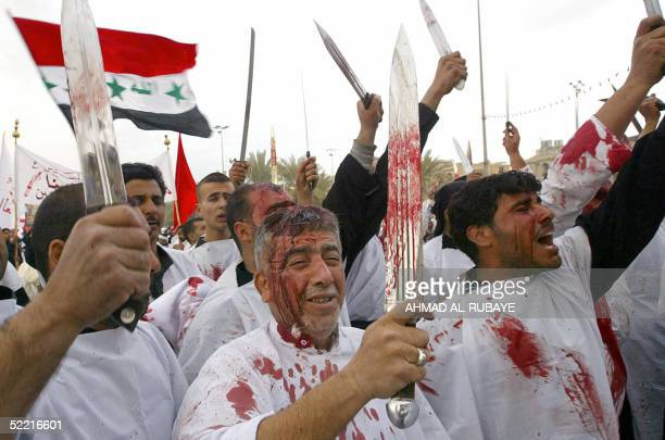 Iraqi Muslim Shiites flagellate themselves outside Imam alHussein shrine in the holy city of Karbala south of Baghdad 19 February 2004 at the peak of...