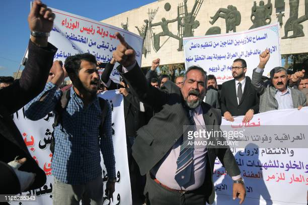 Iraqi Muslims and Yazidis demonstrate in Tahrir Square in central Baghdad on March 1 to demand investigations on the mass grave found near the...