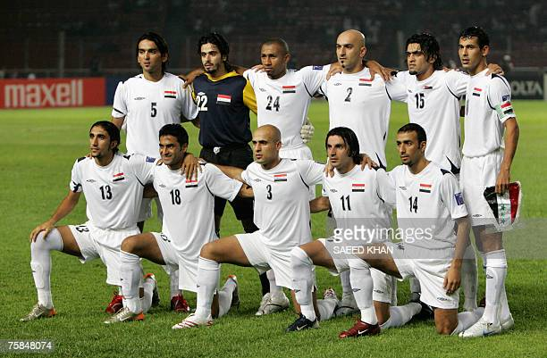 Iraqi national football team members pose for group picture before the start of the final match of the Asian Football Cup 2007 between Iraq and Saudi...