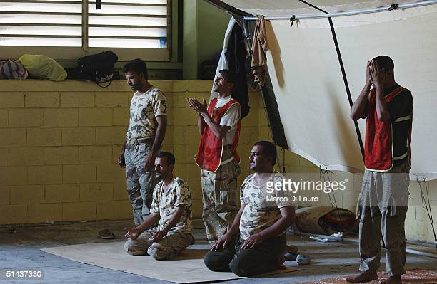 Iraqi National Guard pray during a Junior Command and Leadership Course October 7 2004 in Az Zubayr Port 40 km from Basrah in southern Iraq The...