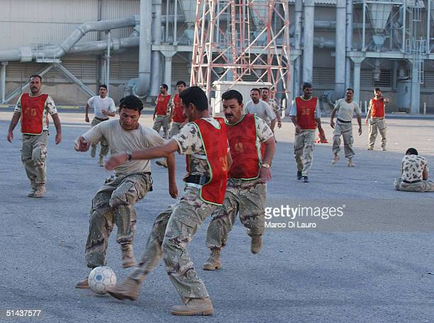 Iraqi National Guards play soccer as they attend phsycal training class on October 7 2004 in Az Zubayr Port 40 km from Basrah in southern Iraq The...