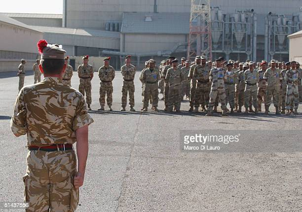 Iraqi National Guards receive instructions from a British Army Sergeant Major from the Black Watch Regiment during a parade on October 7 2004 in Az...