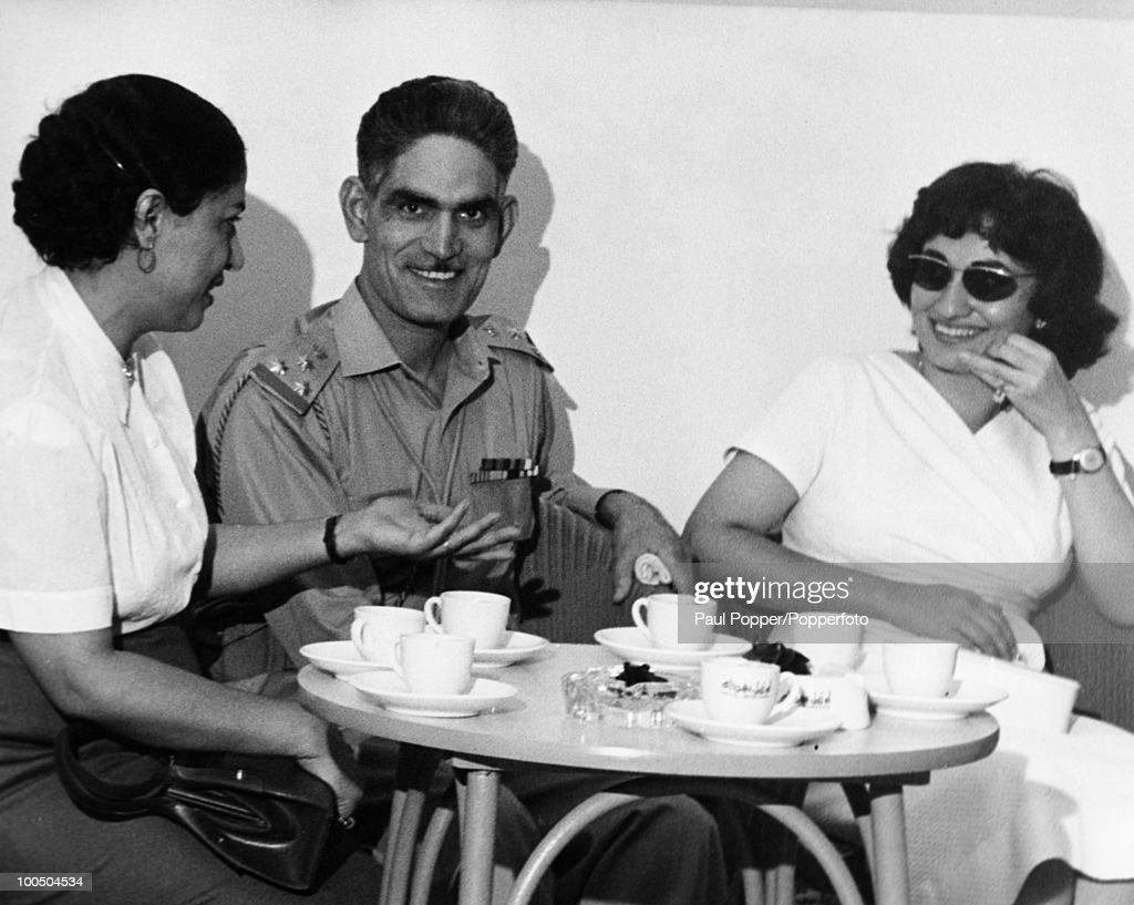 Iraqi nationalist army officer and Prime Minister of Iraq, Abd al-Karim Qasim (1914 - 1963), with delegates to an Afro-Asian solidarity meeting in Baghdad, Iraq, 12th August 1958. On the left is head of the Egyptian delegation, the poet and writer Isha Abdul Rahman. Qasim had seized power a month previously in a military coup.