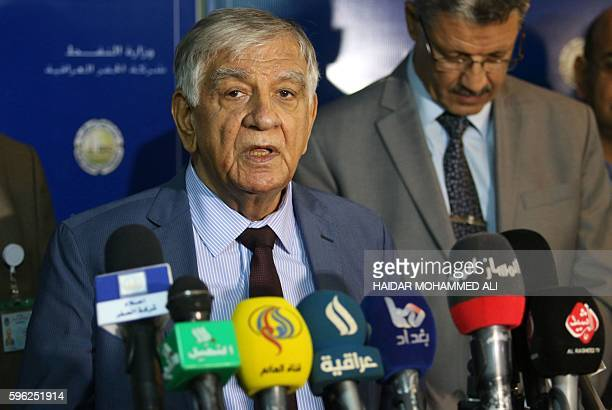Iraqi Oil Minister Jabbar Ali Hussein alAybi speaks during a press conference on August 27 2016 as part of his visit to the oil field of Zubair...