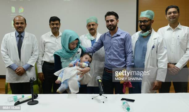 Iraqi parents Gufran Ali and Sarwed Ahmed Nadar pose with their eight month old son Karam and physicians Executive Consultant paediatric surgery...