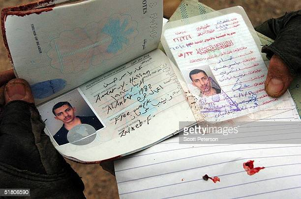 Iraqi passport and identity document of an insurgent are seen after a battle between insurgents and US Marines of the 1st Battalion November 29 2004...