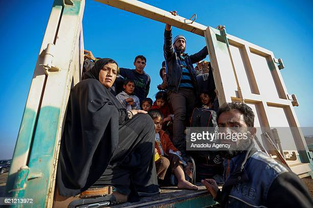 Iraqi people are seen into the vehicle as they wait for security reasons as they fled during clashes between Iraqi army forces and Daesh terrorists...