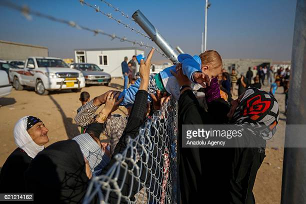 Iraqi people at Khazir refugee camp meet with their relatives in Erbil after they had fled from clashes between Iraqi army forces and Daesh...