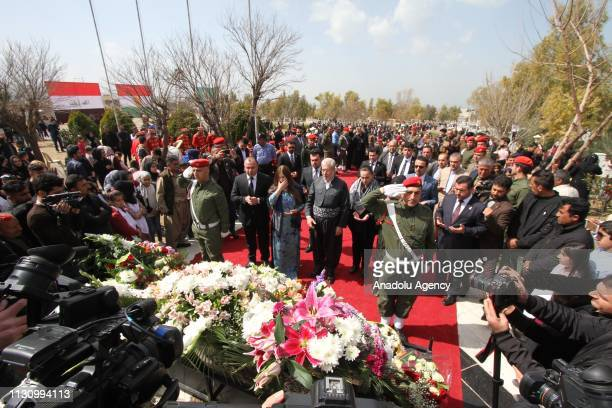 Iraqi people attend a commemoration for the people, who lost their lives on Halabja chemical attack staged on 16 March 1988, at Halabja cemetery in...