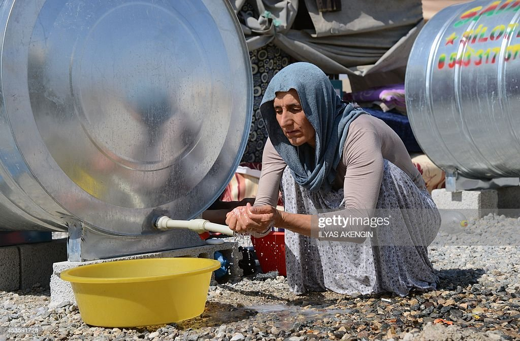 Iraqi people from the Yazidi community are pictured in a refugee camp near the Turkey-Iraq border at Silopi in Sirnak on August 14, 2014. The United States said Wednesday its troops found 'far fewer' Yazidi refugees marooned on a northern Iraqi mountain than expected, making an evacuation mission less likely, after air strikes pummeled besieging Islamic militants.