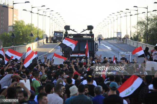 Iraqi people stage a protest against unemployment and power cuts demanding the government's resignation near the Green Zone in Baghdad, Iraq on July...