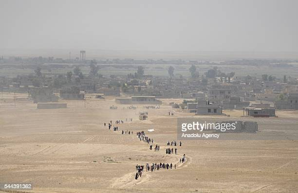 Iraqi people who fled from their villages due to the clashes go to Dibege Tent Camp in Mosul's Mahmur district as Mosul rescue operation from Daesh...