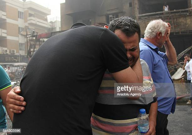 Iraqi people who lost their relatives mourn after a suicide car bombing claimed by the terrorist organization DAESH in the Karrada neighborhood of...