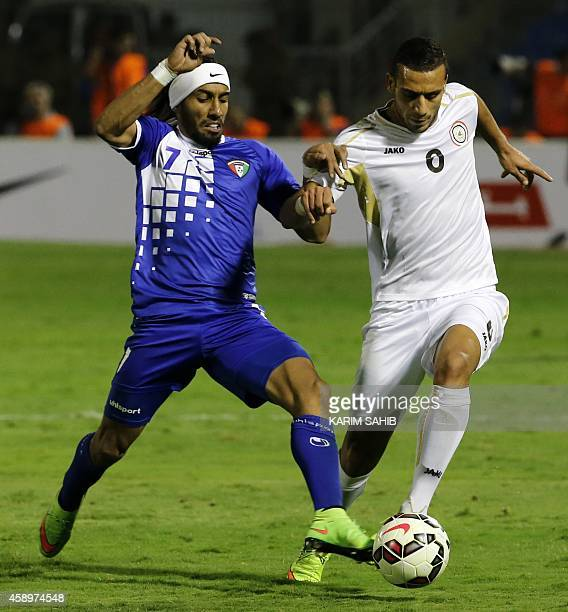 Iraqi player Ali Adnan fights for the ball with Kuwait's Fahad Alenazi during their Gulf Cup football match at the Prince Faisal bin Fahad Stadium in...