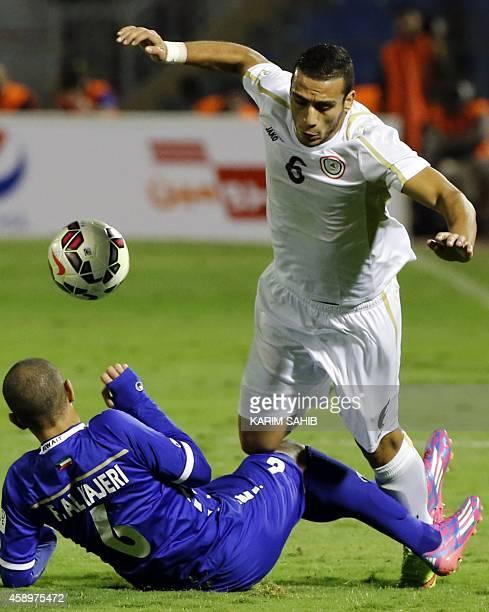 Iraqi player Ali Adnan is tackled by Kuwait's Fahad Al Hajery during their Gulf Cup football match at the Prince Faisal bin Fahad Stadium in Riyadh...