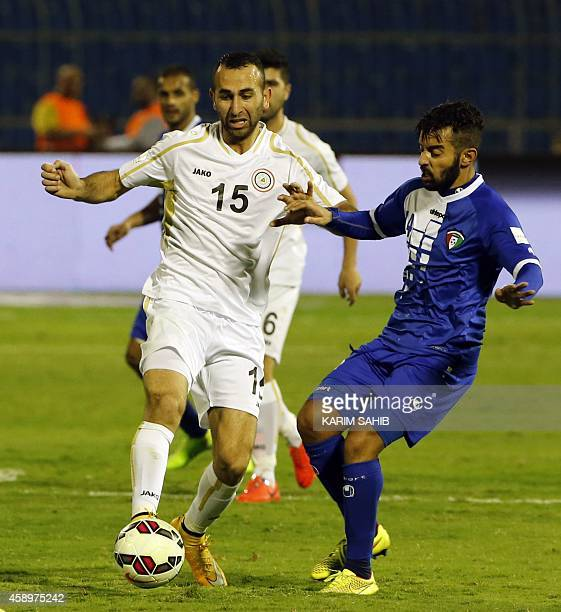 Iraqi player Justin Meram fights for the ball with Kuwait's Talal AlAmer during their Gulf Cup football match at the Prince Faisal bin Fahad Stadium...
