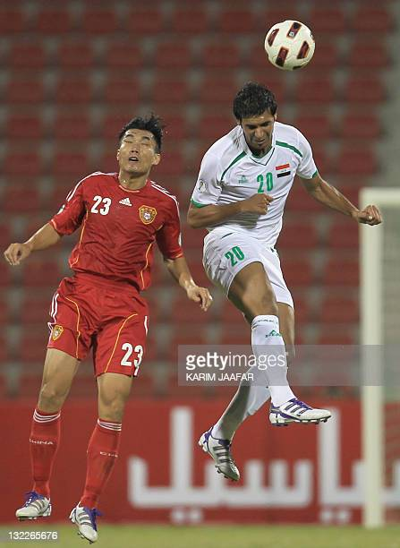 Iraqi player Muthana Khaled fights for the ball against Zheng Zhi of China during the 2014 FIFA World Cup football qualifying round in Doha on...