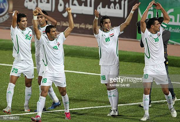 Iraqi players celebrate after scoring a goal against Bahrain during their 20th Gulf Cup football match in the southern Yemeni city of Aden on...