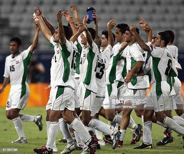 Iraqi players celebrate their 42 victory over Portugal in the men's football preliminary match on August 12 2004 during the Athens 2004 Summer...