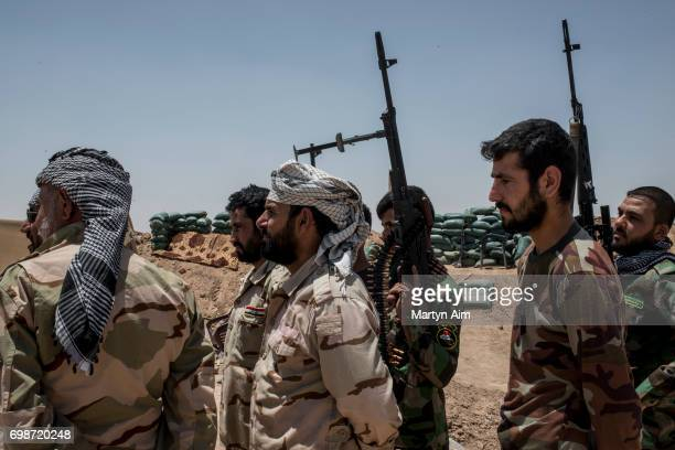 Iraqi PMF fighters June 20 2017 on the IraqSyria border in Nineveh Iraq The Popular Mobilisation Front forces composed of majority Shi'ite militia...