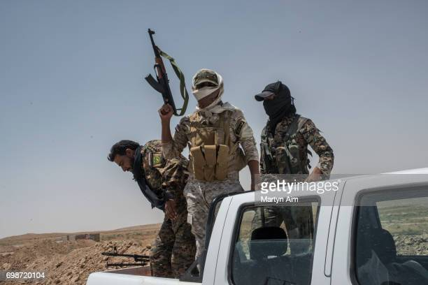 Iraqi PMF fighters on June 20, 2017 on the Iraq-Syria border in Nineveh, Iraq. The Popular Mobilisation Front forces, composed of majority Shi'ite...