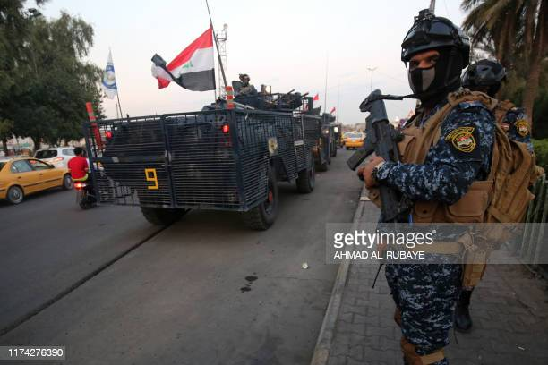Iraqi police are seen deployed in Baghdad's predominantly Shiite Sadr City on October 7 2019 Demonstrations across Baghdad and the south have...