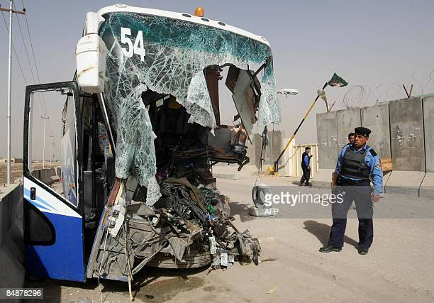 Iraqi police inspect the damaged bus that slammed into the back of a British Army armoured vehicle late last night west of the city of Basra some...