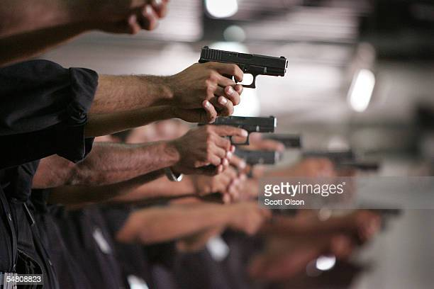Iraqi Police learn to shoot a 9mm pistol at the Jordan International Police Training Center September 3 2005 in Amman Jordan About 300 instructors...
