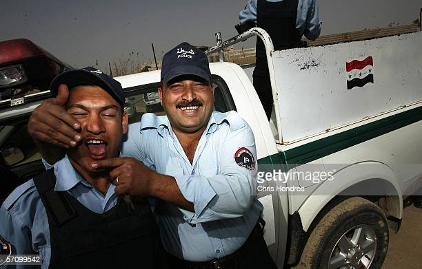 Iraqi police officers joke around prior to a patrol March 15 2006 in Abu Ghraib Iraq US forces are helping Iraqi police forces reconstitute in the...