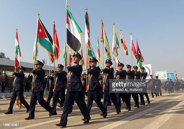 Iraqi police officers march during a parade to mark 90 years since the foundation of the Police Force in the capital Baghdad on January 9 2012 The...