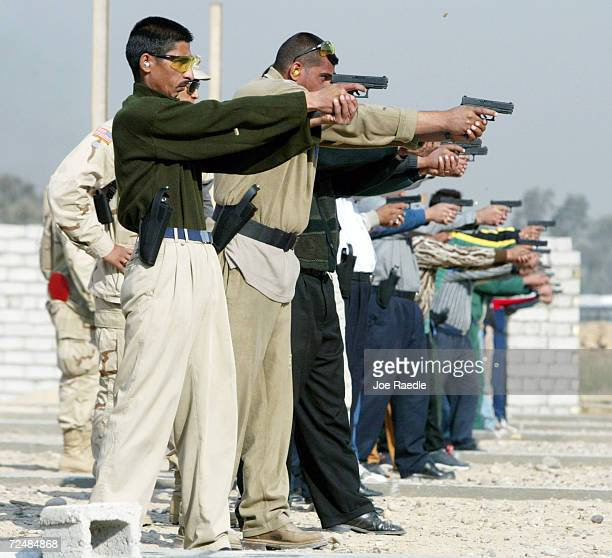 Iraqi police under the guidance of the US Army 382nd Military Police fire their new 9mm pistols November 20 2003 in Baghdad Iraq The Iraqi police are...
