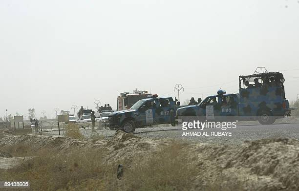 Iraqi police vehicles block one of the entrances leading to Camp Ashraf home to the People's Mujahedeen Iran's main exiled opposition in Diyala...