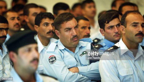 Iraqi police wait to receive their diplomas showing they graduated from the U.S. Army 720 Military Police Battalion three week training program...
