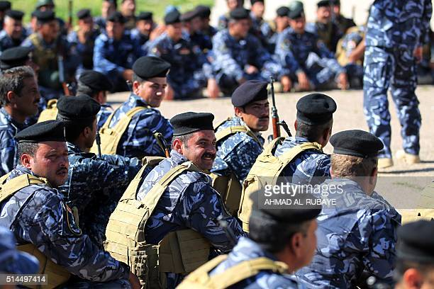 Iraqi policemen from Nineveh Liberation Forces attend a training session at the Speicher military base ahead of joining an operation aimed at...